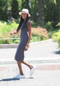 Polka dot dress, white fedora hat, and adidas sneakers