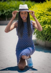 Polka dot dress, white fedora hat, and adidas sneakers