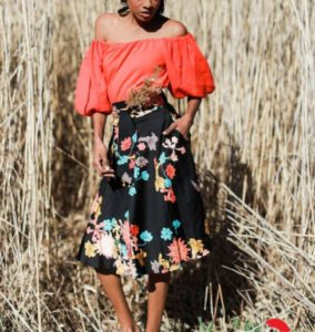 Standing Bold blouse-floral skirt
