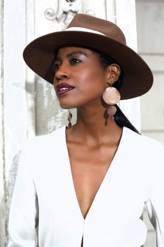 Headshot neutral with a Brown Hat