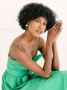Angelica Guillen in a green dress